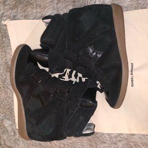 Black Isabel Marant sneakers.